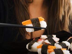 Eating sushi,Eating sushi,Eating sushi,Eating sushiの写真素材 [FYI00774485]