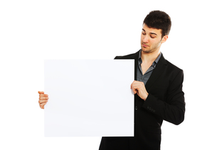 Young businessman holding blank boardの写真素材 [FYI00774529]