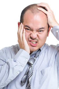Businessman suffer from toothache and headacheの写真素材 [FYI00774567]