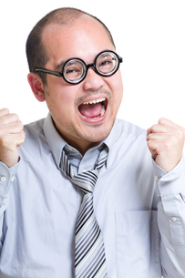Excited businessman yell with somethingの写真素材 [FYI00774596]
