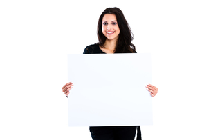 Young woman holding blank boardの写真素材 [FYI00774621]