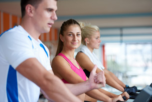 friends  exercising on a treadmill at the bright modern gymの写真素材 [FYI00775255]