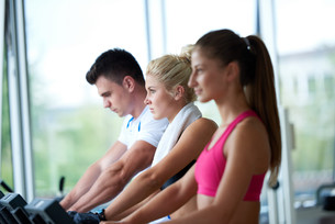 friends  exercising on a treadmill at the bright modern gymの写真素材 [FYI00775287]