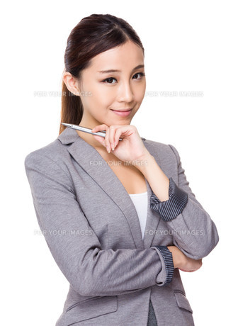 Asian businesswoman hold a penの写真素材 [FYI00775627]
