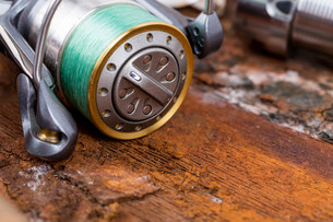 fishing reel with line on backgroundの写真素材 [FYI00775862]