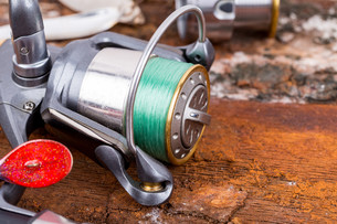 fishing reel with line on backgroundの写真素材 [FYI00775874]