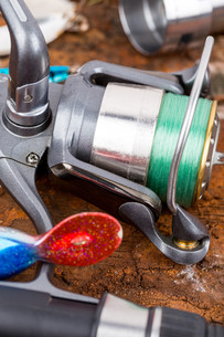 fishing reel with line on backgroundの写真素材 [FYI00775876]