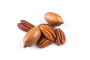 Few pecan nuts isolated on whiteの素材 [FYI00776236]