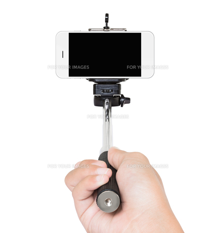 hand holding selfie stick isolated white clipping path insideの写真素材 [FYI00776316]