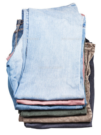top view of stack of various jeans and corduroysの写真素材 [FYI00776473]