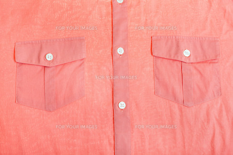 pockets and buttons of red shirt close upの素材 [FYI00776485]