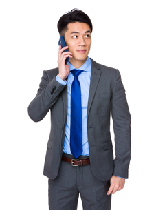 Businessman talk to mobile phoneの写真素材 [FYI00776964]