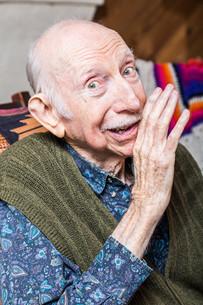 Elder Man Sharing a Secretの写真素材 [FYI00777194]