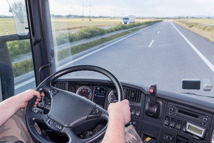 Driving truck on the highwayの写真素材 [FYI00777475]