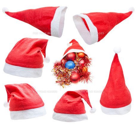 set of traditional red santa claus hat isolatedの写真素材 [FYI00778205]