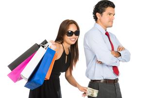 Shopping Smiling Female Removing Money Husband Hの写真素材 [FYI00778219]