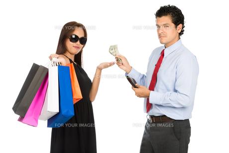 Asian Woman Shopper Accepting Money Husband At Hの写真素材 [FYI00778229]