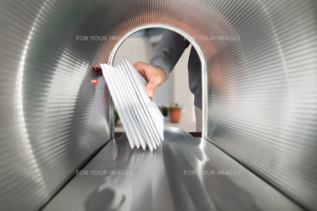 Person Hands Taking Letters View From Inside The Mailboxの素材 [FYI00778469]