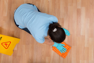 Woman Rubbing Wooden Floor With Clothの写真素材 [FYI00778702]