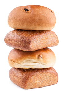 wholemeal and raisin bun stack on a white backgroundの写真素材 [FYI00778821]
