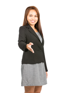 Smiling Handshake Greeting Asian Facing Cameraの写真素材 [FYI00778997]