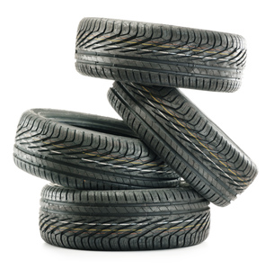 Four new black tires isolated on whiteの写真素材 [FYI00779167]
