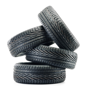 Four new black tires isolated on whiteの写真素材 [FYI00779197]