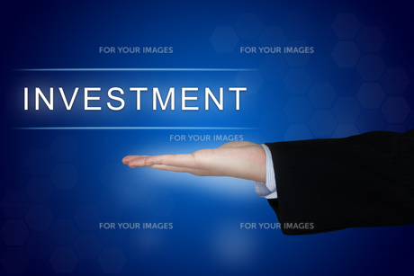 investment button on blue backgroundの写真素材 [FYI00779221]
