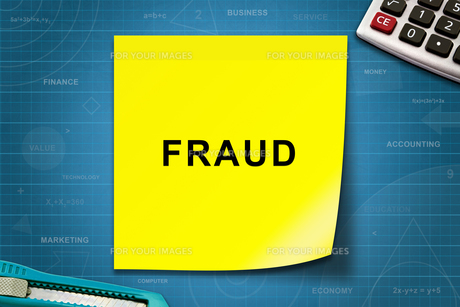 Fraud word on yellow noteの写真素材 [FYI00779223]