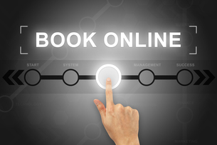 hand clicking book online button on a screen interfaceの素材 [FYI00779227]