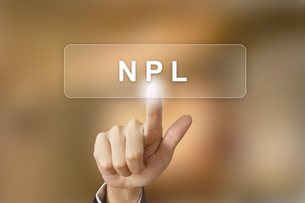 business hand clicking NPL or non performing loans button on blurred backgroundの写真素材 [FYI00779228]