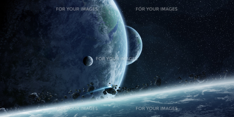 Sunrise over planet Earth in spaceの写真素材 [FYI00779379]