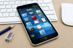 Workplace with mobile phoneの写真素材 [FYI00779380]