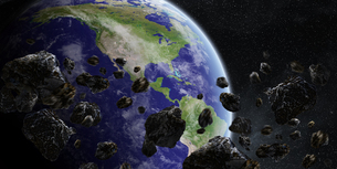 Asteroids threat over planet earthの写真素材 [FYI00779393]