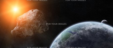 Asteroids threat over planet earthの写真素材 [FYI00779408]
