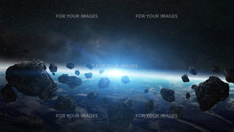 Asteroids threat over planet earthの写真素材 [FYI00779413]