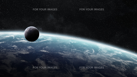 Sunrise over planet Earth in spaceの写真素材 [FYI00779420]