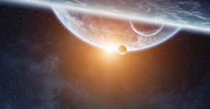 Sunrise over planet Earth in spaceの写真素材 [FYI00779432]