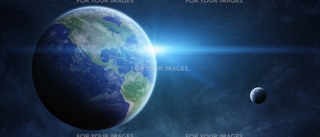 Sunrise over planet Earth in spaceの写真素材 [FYI00779451]