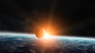 Sunrise over planet Earth in spaceの写真素材 [FYI00779481]