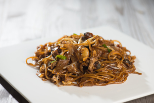 Fried Penang Char Kuey Teow which is a popular noodle dish in Malaysia, Indonesia, Brunei and Singaporeの写真素材 [FYI00779592]