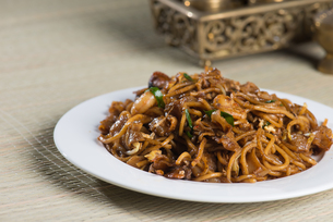 Fried Penang Char Kuey Teow which is a popular noodle dish in Malaysia, Indonesia, Brunei and Singaporeの写真素材 [FYI00779600]