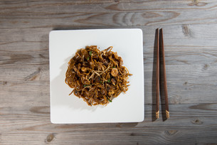 Fried Penang Char Kuey Teow which is a popular noodle dish in Malaysia, Indonesia, Brunei and Singaporeの写真素材 [FYI00779605]