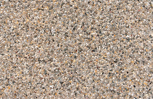 colored aggregate concrete with gray,brown and yellowish pebblesの写真素材 [FYI00779928]