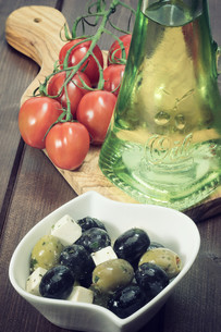 Vintage photo of salad of cheese, black and green olives.の写真素材 [FYI00779963]