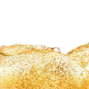 Golden drink bubbles against white backgroundの写真素材 [FYI00780084]