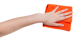 hand with orange dusting rag isolated on whitの写真素材 [FYI00780331]