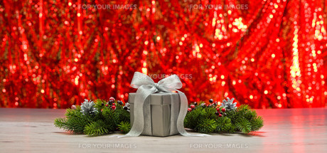 Silver present and Christmas tree branchesの素材 [FYI00780488]