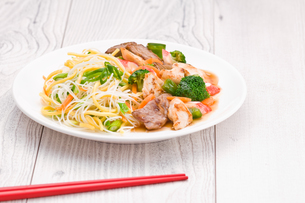 Noodles with Chicken Beef and Crab Stickの写真素材 [FYI00780548]