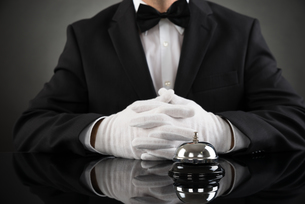 Waiter With Service Bell At Deskの写真素材 [FYI00781050]